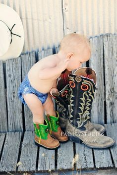 how cute is he with his blue jean diaper & john deere boots!