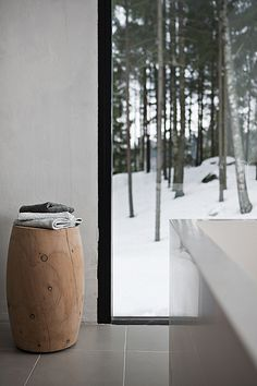 the wood softens the sleek lines (home of ulla koskinen)