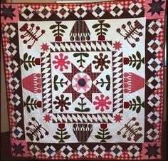BOM, Tip Toe through the Tulips, designed by Wendy of Legends and Lace.  Photo from Humble Quilts blog.