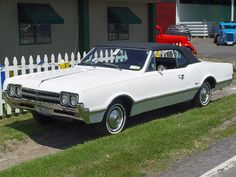 1966 Oldsmobile Cutlass Convertible - White - Front Angle - 1152x864 Wallpaper    Image Copyright Serious Wheels