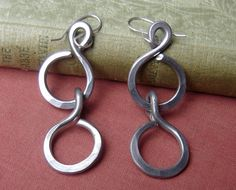 Big and long but super light weight. Really! They are made of aluminum but the earwires are sterling silver.Big Long Chunky Chain Earrings  Light Weight by nicholasandfelice, $ 16.00