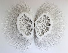 Intricate Organic Forms Cut from Paper by Rogan Brown sculpture paper