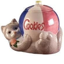 Cat Holding a Ball Cookie Jar