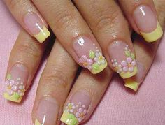 Soft pastel yellow french manicure tips with pink & white floral, flowers, green leaves, & polka dots done with 3D acrylic paint, free-hand nail art