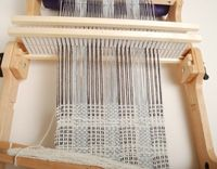 How to weave mixed-density scarves on a rigid-heddle loom with two heddles.