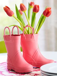 Rain boots as vases.