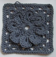 Bulky granny square with a flower