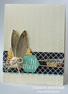 Hooray for Feathers | A Happy Hooray feather embossed in gold. Emboss the background with clear embossing powder on Very Vanilla card stock and the Handcarved background stamp. The dsp on this card is from Back to Black.