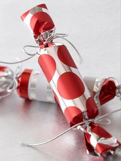 Christmas Crackers  Make these simple Christmas crackers to use as stocking stuffers or holiday party favors. For each cracker, cut a 5-inch length from a wrapping paper or paper-towel tube. Cut a 10x10-inch square from wrapping paper. Center the tube on the paper and wrap the paper around the tube. Tape along the edge of the paper to secure. Tie one end closed with a length of cord tied in a bow. Fill the tube with small gifts or wrapped candies, then tie the opposite end closed in the same manner.
