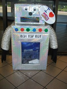 BOX TOP Bot (robot) created by Karen Crawford. Items used:  silver/shiny gift bags, laminating film, gloves, dryer vent tubing, sponges, milk caps, wiggle eyes, lids, boxes, & hot glue.  Easy to make!  Good Luck & Hope you like my Box Top Robot!  Have fun collecting Box Tops!