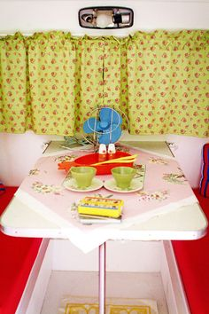 interior of a vintage camper @Jessi King Coulter I think you wanted to cover your seats red, no?