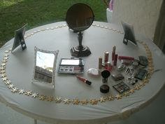 To keep with our theme, and also keep our guest busy....I dug through my old makeup drawer and pulled out everything I no longer use! I created a makeup table for each guest to get ready for the Runway!