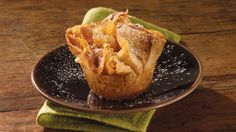"Cooking Club member Dawn Sicurello's experience shaping clay spilled over into the kitchen with this recipe. ""I'm a potter and always working with my hands,"" she says. For this recipe, she pressed phyllo dough into muffin cups to form a crust for a chunky apple filling. The pretty pockets are easy to assemble and fun to serve. ""They sit nicely on a plate or in bowls with ice cream,"" says Dawn."