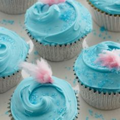 Homemade cupcakes topped with cotton candy frosting