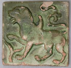Afganistan early C13th molded earthenware green glazed tile depicting heraldic animal tile depict, glaze tile, mediev tile