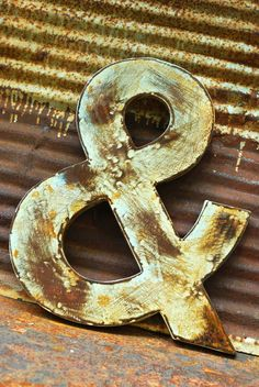 "16""H Rusted Metal Ampersand. $50.00, via Etsy."