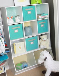 Rebecca snazzed up this white storage unit with colorful backgrounds and cubbies.