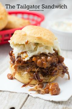 The Tailgator, the ultimate sandwich for a tailgating party. Corn biscuits stuffed with pulled pork, baked beans and coleslaw! ohsweetbasil.com