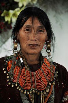 Nagaland, NE India | A Konyak Naga lady adorned in traditional finery.| © Rokovor Vihienuo