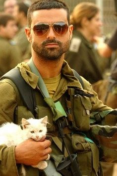 Soldiers with their cats