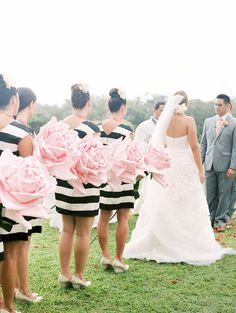 striped bridesmaids dresses, photo by Ashley Goodwin http://ruffledblog.com/kate-spade-inspired-wedding-in-hawaii #weddingceremony #flowers