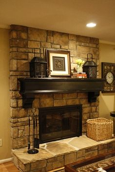 I LOVE this fire place, the chunky mantle and decor that goes with it. IF I ever had a fireplace installed in the family room, this is what I would want!