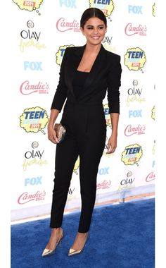 Selena Gomez WHAT:  Saint Laurent jumpsuit, Jennifer Meyer earrings, Dior bag, Miu Miu shoes WHERE:  Teen Choice Awards, Los Angeles