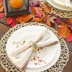 Modern, natural, and rustic elements combine to make this beautiful table setting! More fall decor ideas: http://www.bhg.com/thanksgiving/decorating/fall-table-settings/?socsrc=bhgpin101813rustictablesettings&page=8