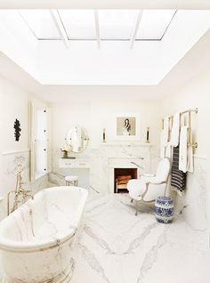 bathroom // ceiling // fireplace // stone // bathtub