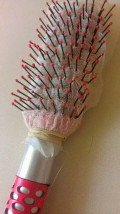 Avoid that winter static hair! Simply put a dryer sheet on your brush and secure it with a rubber band.