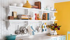 These built-in shelves have the elegance of fine furniture with open storage and a rod for hanging pots and pans.
