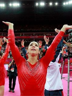USA women celebrate Artistic Gymnastics team win