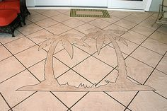 Concrete logos are a great decorative option for patios and pool decks, like this palm tree design.  Royal Coat Inc Morehead City, NC