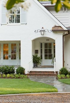 Gorgeous! White painted brick and pale minty trim. LUCY WILLIAMS INTERIOR DESIGN BLOG