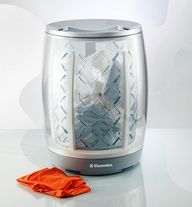 It's a hamper/washer/dryer. After you fill it up, an automatic wash and dry cycle initiates and texts when done.    This would be GREAT for stinky workout clothes.