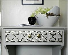 DIT CRAFTS Can you believe that Decor Hacks made this nailhead side table for less than $6?