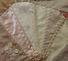Beautiful crazy quilting with vintage buttons...