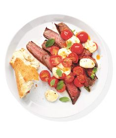 Steak With Mozzarella and Tomatoes--we usually like a little starch, so I'll sub out the bread for some dressed couscous.
