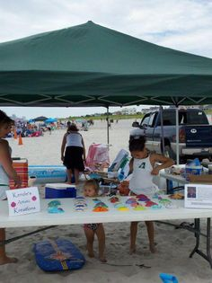 """9 year old Mackenzie Allen was hard at work selling """"Kenzie's Artistic Kreations"""" at her tent ...."""