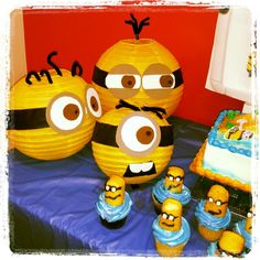 Minions birthday party theme. Turn yellow Chinese lanterns into minions.