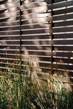 woven metal-slat fence