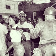 Gloria Richardson removes the rifle of a National Guardsman from her way during a 1963 Civil Rights Protest