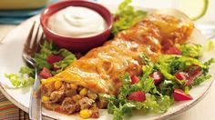 Try these easy cheesy ground beef enchiladas, with sassy sauce and mild chiles. Speed up your prep by using thawed Make-Ahead Ground Beef in place of the ground beef and onion.