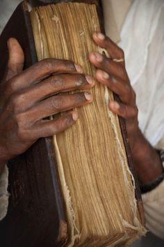 Priest in Bahir Dar, Ethiopia, holding a bible    ©Nancy Carels