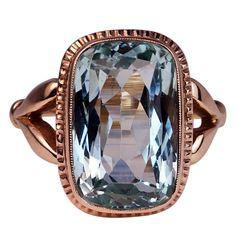 Russian Aquamarine Rose Gold Ring. A 9 carat cushion-cut aquamarine set in 14K rose gold. St. Petersburg, ca. 1908-1917.
