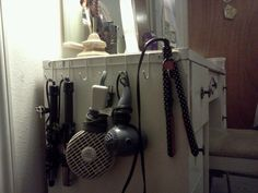 Vertical organization. Pink Stinx: Hair Appliance Organization, hook mount used for hanging hair appliances from Dollar Tree!