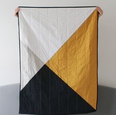 Add a beautiful statement to any room with this handmade Geometric quilt. Available in custom styles and sizes.