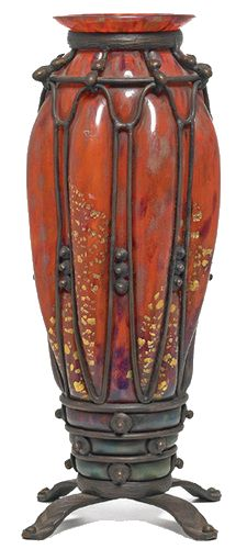 Daum and Majorelle vase. - A French Art Deco wrought iron mounted glass bowl with gold inclusions by Daum Majorelle c1930. From 1900 Majorelle began to collaborate with Daum Frères. Majorelle was by then designing metal objects such as feet and mounts for Auguste Daum's glass lampshades. In exchange, Daum Frères made the glass elements for Majorelle's own collections