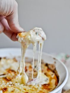 White Pizza Dip with Cream Cheese, Mozzarella, Provolone, Parmesan, Basil, and Tomatoes.