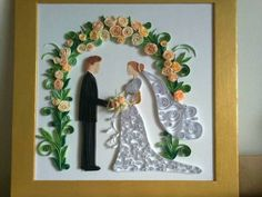 Quilled Bride and Groom - by: Emese Dobos - as seen on the FB group board of the World of Quilling.